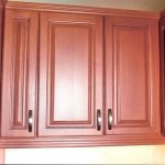 Faux cherry wood look on old oak cupboards